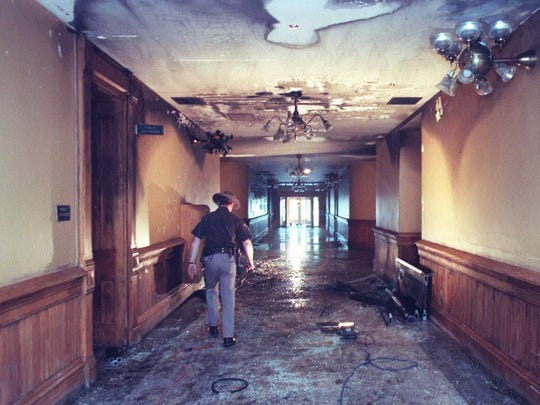 Tippecanoe County Sheriff's Department Lt. Bob Miller walks through the first floor hallway of the Tippecanoe County Courthouse in Lafayette Ind. Monday Aug. 3 1998. A stolen pickup truck carrying a homemade bomb drove through the doors of the courthouse and ignited an accelerant on board causing a fire that heavily damaged the building. The bomb did not explode nobody was injured and the driver fled in what authorities called a terrorist attack on the Tippecanoe County Courthouse Sunday night.
