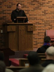 Pastor John Hobbins of First United Methodist Church reads an Old Testament lesson during the service.  Nine Oshkosh congregations took part in a years-long tradition by singing and worshiping together at the First United Methodist Church on Good Friday. The ministries welcomed the newly formed African Fellowship of Oshkosh and the Fox Valley.