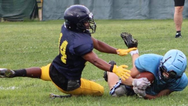 Frankfort's Jake Clark (13) makes a diving catch while defended by Moorefield's Adikilt Tamiru (140).