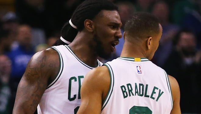Jae Crowder of the Boston Celtics celebrates with Avery Bradley during the fourth quarter against the Utah Jazz at TD Garden on February 29, 2016 in Boston, Mass.