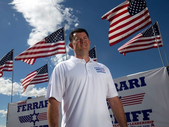 Shane Ferrari stands next to campaign signs in August at McGee Park in Farmington. Ferrari is one of two announced candidates for San Juan County Sheriff. The other is Farmington resident Tommy Bolack.