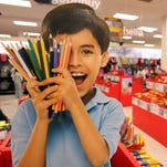 Julie Wilkins shops with her grandson, Griffin Brady, 3, at a Target in Memphis during last year's back-to-school season.