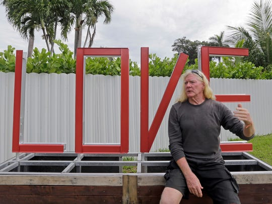"""In this photo taken, Aug., 11, 2016, Mickey Munday talks to a reporter in Love Park in North Miami, Fla. When he was one of Miami's notorious """"cocaine cowboys"""" in the 1980s, Mickey Munday made millions of dollars flying loads of drugs for Colombia's Medellin and Cali cartels. He knew infamous Medellin kingpin Pablo Escobar. He liked to fly his illicit cargo to out-of-the-way landing strips in the Everglades using high-tech gadgetry such as night-vision goggles."""