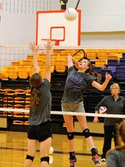 Wylie's Karis Christian goes for a kill during Monday's
