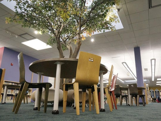The fake tree, which actually looks very real, will remain in the library.