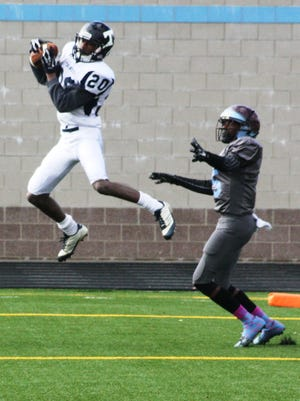 Thurston's Robert Thomas picks off a pass in the end zone against Mumford.