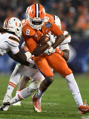 Clemson wide receiver Deon Cain (8) makes a reception against Miami during the 3rd quarter of the ACC championship game against Miami at Bank of America Stadium in Charlotte on Saturday, December 2, 2017.