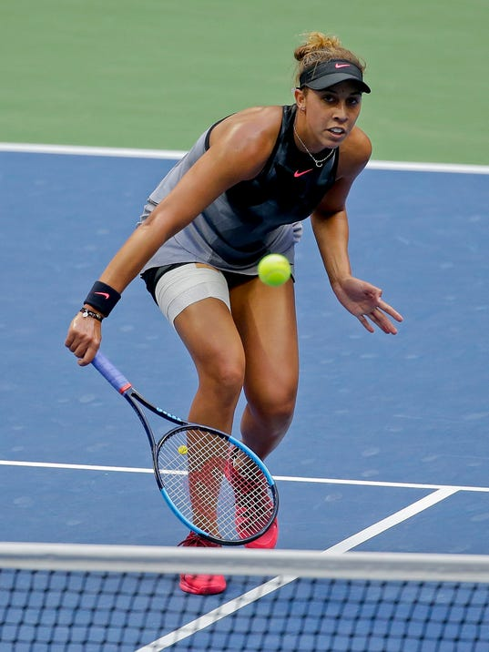 Madison Keys, of the United States, returns a shot from Sloane Stephens, of the United States, during the women's singles final of the U.S. Open tennis tournament, Saturday, Sept. 9, 2017, in New York. (AP Photo/Seth Wenig)