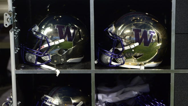 Washington Huskies helmets on the sidelines during the game against the UCLA Bruins at Rose Bowl.