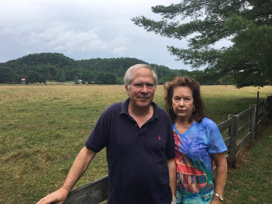 Scott and Peggy Ballin pose for a photo on their Deerfield property, through which the Atlantic Coast Pipeline is routed to intersect. Photo taken on Thursday, July 27, 2017, in Deerfield, Va.