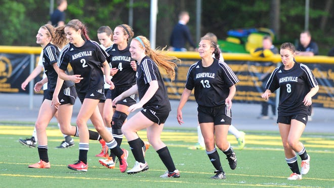Asheville High soccer players celebrate a goal Friday in Waynesville. Sarah Sirkin (4), Kaileigh Mora (13) and Kenzie McDowell (8) scored in the 4-0 win over Tuscola.