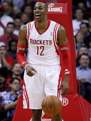 Houston Rockets center Dwight Howard (12) reacts to a play during the second quarter against the San Antonio Spurs at Toyota Center.