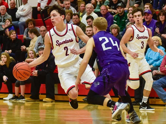 Pleasant's Nick Kimmel runs the ball up the court against Mount Gilead in a tournament game last season.