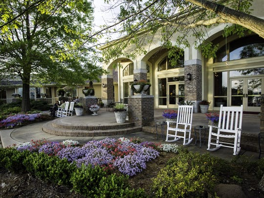 The veranda at the Cypress Bend Golf Resorts offers great views of the golf course and lake.