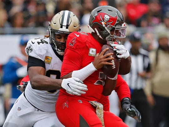 New Orleans Saints defensive end Cameron Jordan (94) sacks Tampa Bay Buccaneers quarterback Jameis Winston (3) during the second half of an NFL football game Sunday, Nov. 17, 2019, in Tampa, Fla. (AP Photo/Mark LoMoglio)