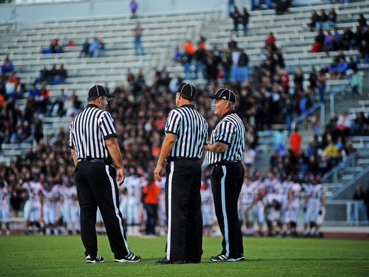 High school football officials meet during a game between Roosevelt and Washington on Sept. 5. There were 1,119 registered officials in the SDHSAA in 2013-14, and some are worried that there could be a shortage of refs soon.
