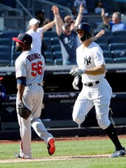New York Yankees' Giancarlo Stanton runs past Minnesota Twins relief pitcher Fernando Rodney (56) to score on a three-run home run by Gary Sanchez during the ninth inning of a baseball game Thursday, April 26, 2018, in New York. The Yankees won 4-3.