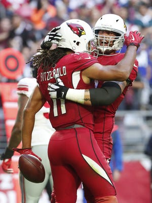 Arizona Cardinals wide receiver Larry Fitzgerald (11) celebrates his touchdown catch with quarterback Drew Stanton (5) against the New York Giants during the second quarter at University of Phoenix Stadium in Glendale, Ariz. December 24, 2017.