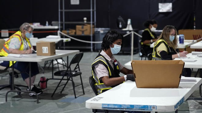 Workers prepare absentee ballots for mailing at the Wake County Board of Elections in Raleigh Thursday. North Carolina is scheduled to begin sending out more than 600,000 requested absentee ballots to voters on Friday.