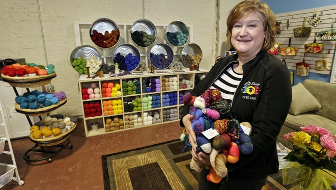 Pam Smith, owner of The Lost Sheep Yarn Shop, holds specialty hand-dyed wool yarn her shop offers Friday January 13, 2017 in Sheboygan.  The wool can be used for projects such as hand knit socks.