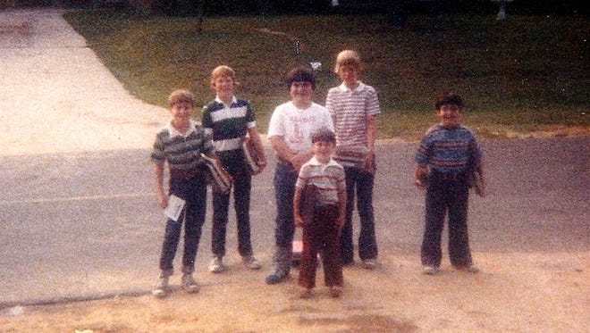 The author (center in white shirt), his brothers and a couple of friends waiting at the bus stop in 1978.