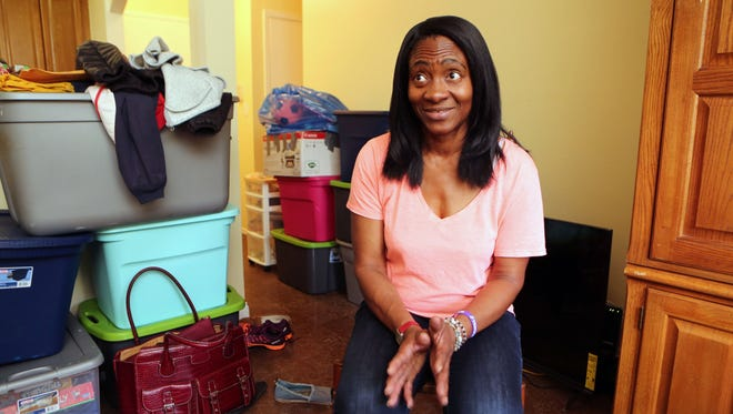 Sheila Vereen-Massengale is pictured with her moving boxes, as she talks about her new apartment in Ossining, Oct. 28, 2016.