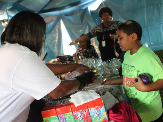 Families look through goods at The Love Center.