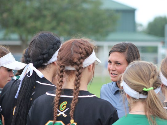 Calvary coach Tiffany Frazier talks with her team during