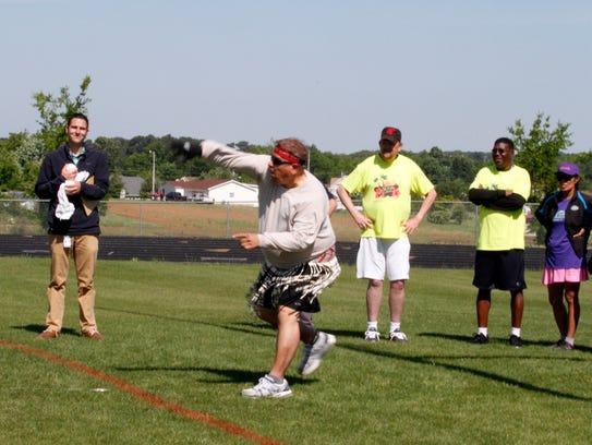 Ivan Adames takes on the softball throw in Polynesian