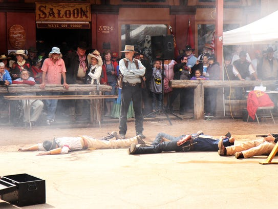 TOMBSTONE: Costumed stuntmen re-enact a Wild West shootout