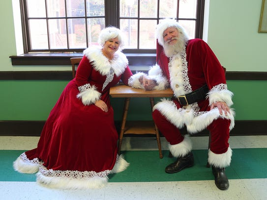 Laura and Jim Elliot pose as Santa and Mrs. Claus.