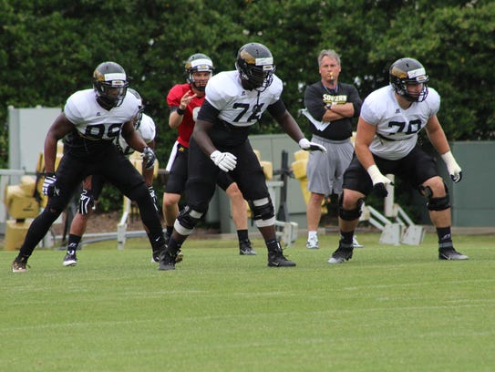 Southern Miss' Ty Pollard, center, started 12 games