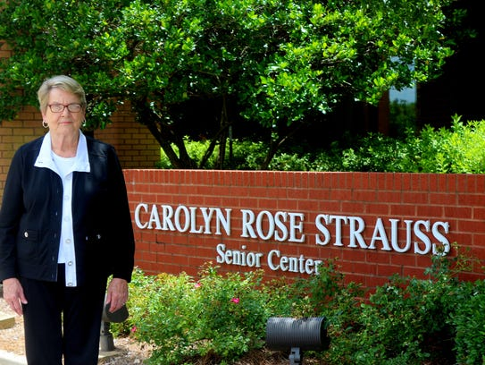 Lynda McGehee stands in front of the Carolyn Rose Strauss