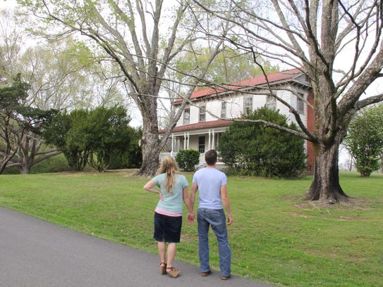Chad and Erin Bates Paine look for a house on Thursday