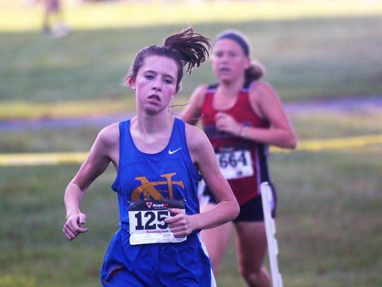 Abby Jones of NCC runs to the win in the NKAC cross