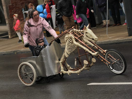 Cole Thompson rides down Main St. during the annual