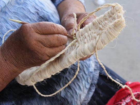 Snow white yucca fiber is used to create these aboriginal