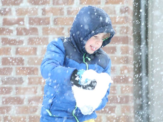 Oliver Duncan, 6, plays in the snow Dec. 8 in Hattiesburg.