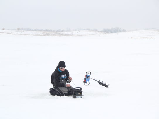 Tyler Mohr of Winona, Minn. ice fishes on Devils Lake,