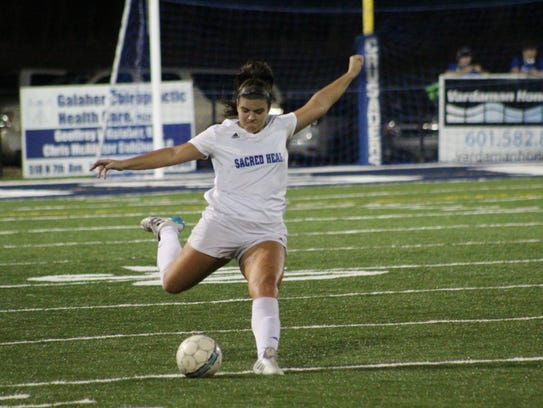 Sacred Heart's Gabby Falla winds up to kick the ball