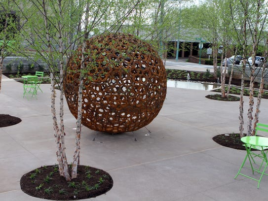 "The ironworks sphere, titled ""Window to the World,"""