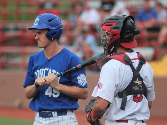 CovCath senior Michael Schaefer at the plate and St.