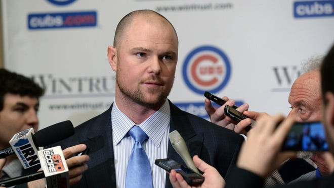 Chicago Cubs pitcher Jon Lester greets members of the media during opening night of the annual Cubs Convention, Friday, Jan. 16, 2015 in Chicago.