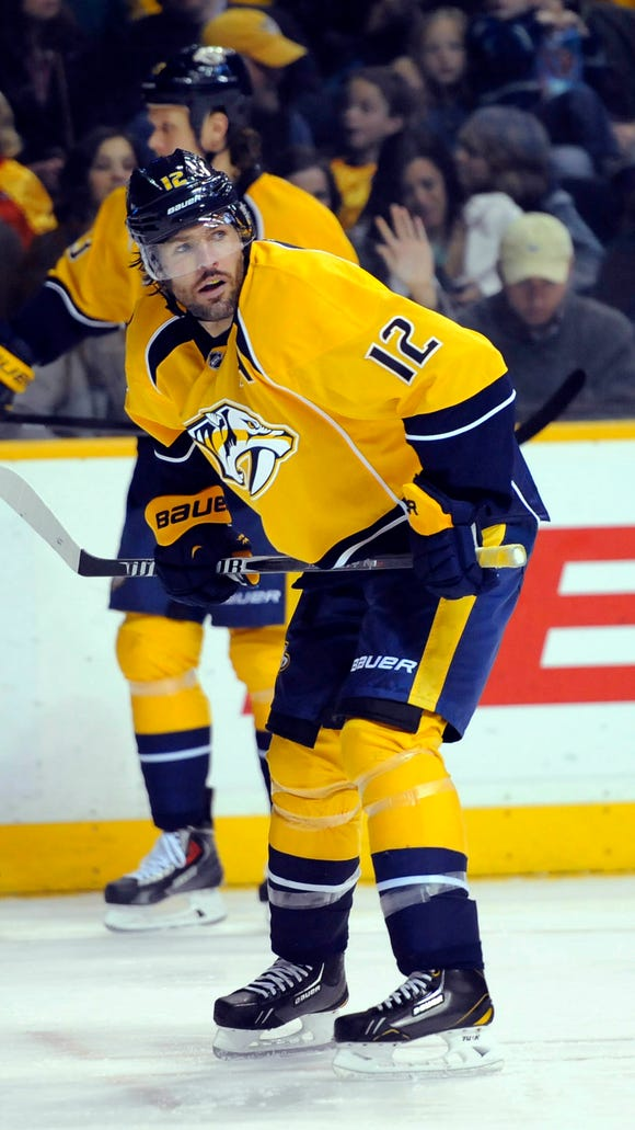 Nashville Predators center Mike Fisher (12) during the first period against the Edmonton Oilers at Bridgestone Arena. Mandatory Credit: Christopher Hanewinckel-USA TODAY Sports