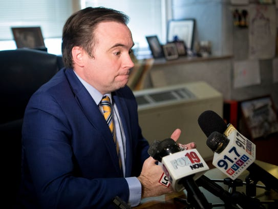 Mayor John Cranley speaks to the press about asking