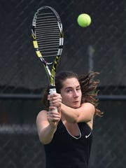 Sofia Phillips, of Clarksville, hits the ball back