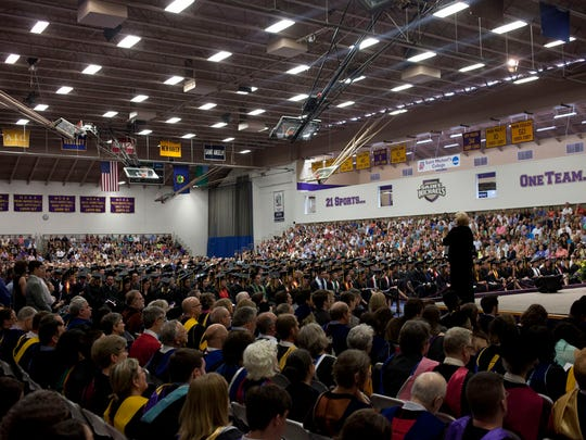 Graduating seniors take their seats before commencement