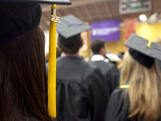 Graduating seniors of St. Michael's College listen