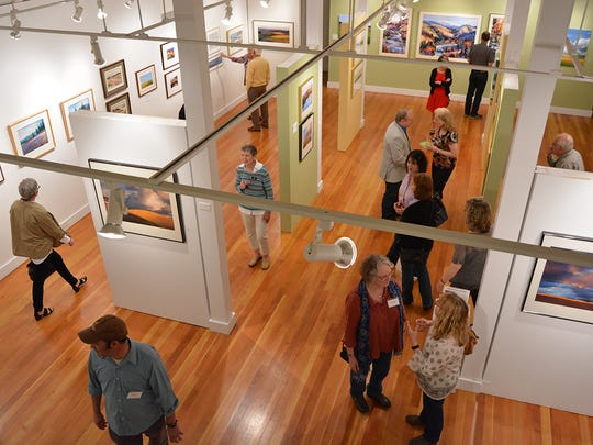 "Patrons view ""The Debra and Edward L. Allis Collection"" that is on exhibit through June 27 at the Bush Barn Art Center."