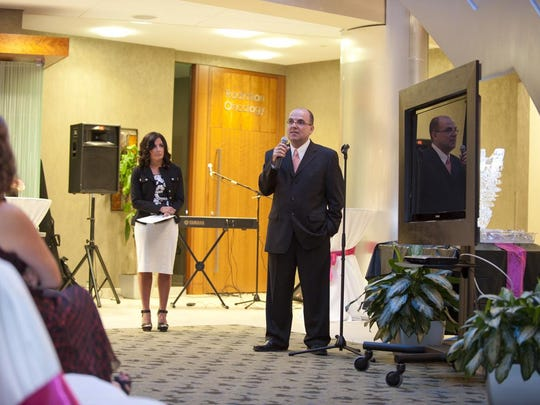 Dr. Farid Fata speaks at a September 2011 fundraising event for his Swan For Life Cancer Foundation, which he established to provide support and resources for cancer patients, survivors and their family and friends.